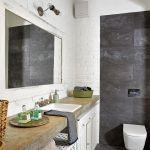 Dominuje kolor szarego surowego betonu i bieli. Dodatki w ciepłym kolorze wikliny.