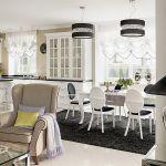 Szafki kuchenne są w tym samym stylu co meble w salonie.