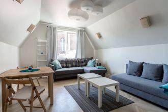 Dwie rozkładane kanapy można ze sobą połączyć, tworząc rodzaj wygodnego narożnika.