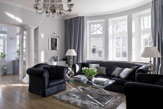 Rezydencja na Mokotowie: klasyczna elegancja w czerni i bieli.