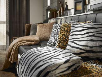 Brązowe i drewniane akcenty we wnętrzach przywołują na myśl uczucie komfortu i relaksu, ale są też symbolem stabilności i