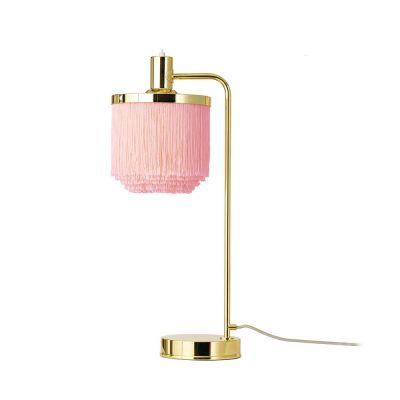 różowa lampka z frędzlami