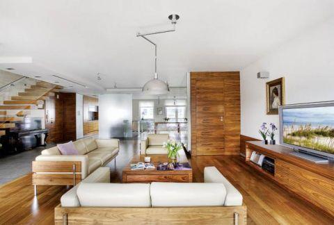 Salon połączony z kuchnią. Apartament palisandrowy