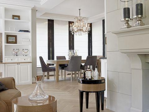 Biało-czarno-szare kolory, konsekwetnie utrzymane w całym domu, wprowadzaja klimat wysublimowanej elegancji.