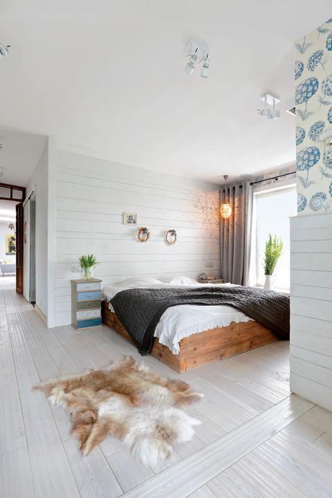 aranżacja poddasza ze skosami sypialnia w stylu skandynawskim