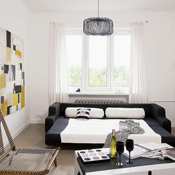 Obraz Joanny Puzzle a do niego idealnie dobrane meble: kanapa Comfort Living, fotel-leżanka