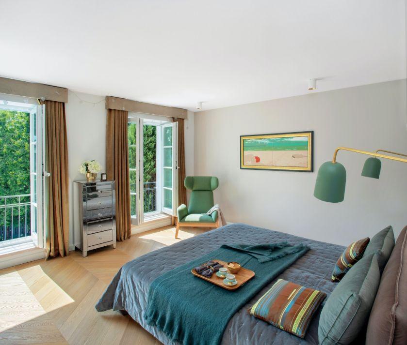 sypialnia z zielonymi dodatkami